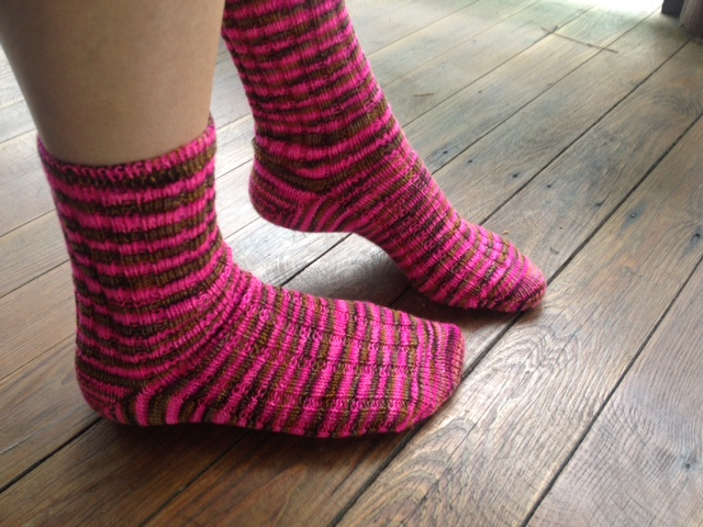 Finished ribbed socks on US 0 dons; toe up with a FLK heel and tubular bind off.