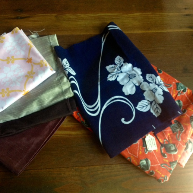 Sale finds include silk remnants, a 1/2 yard cut of cotton laminate, a piece of vintage Japanese katagami fabric, and three yards of telephone print.