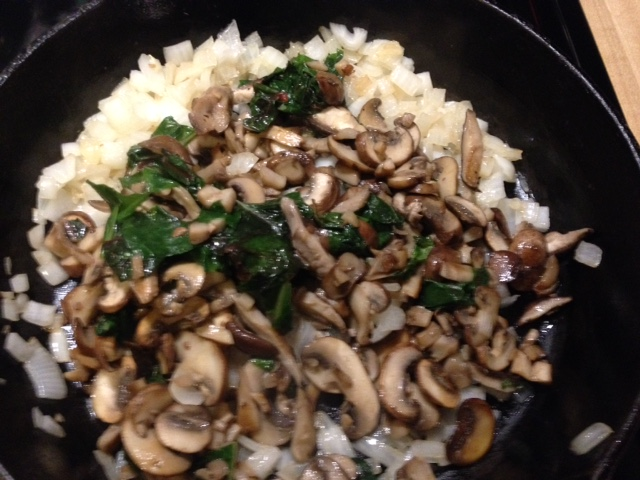 While the bread is toasting, saute (separately) sliced mushrooms and chopped onion. Add everything back into the same pan, and toss in a handful or more of chopped bitter greens like kale or Swiss chard. Remove from heat to cool