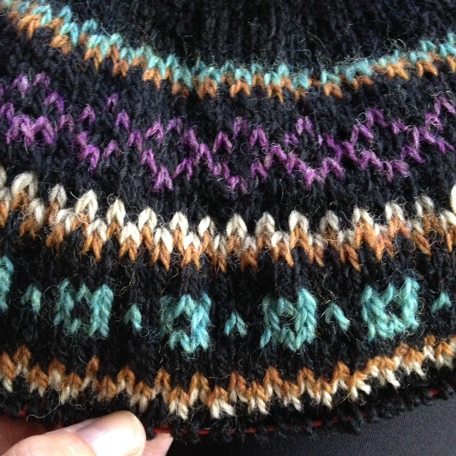 The colorwork yoke of my Bressa dress. I hold the contrasting color in my left hand, the main color in my right.