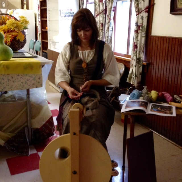 Spinning demonstration in period dress.
