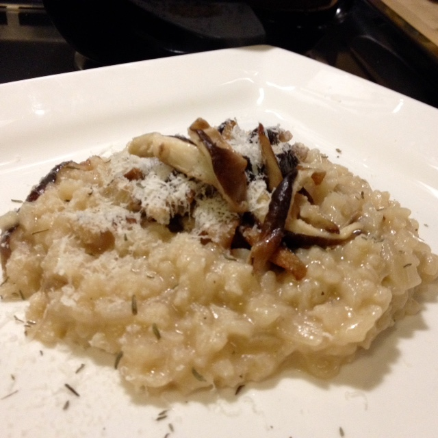 Delicious mushroom risotto with shiitakes harvested right in my kitchen.