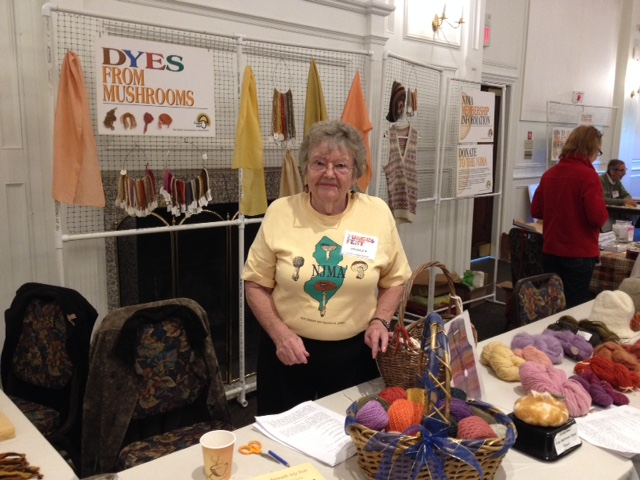 Ursula with her beautiful display of yarn and fiber dyed with mushrooms.