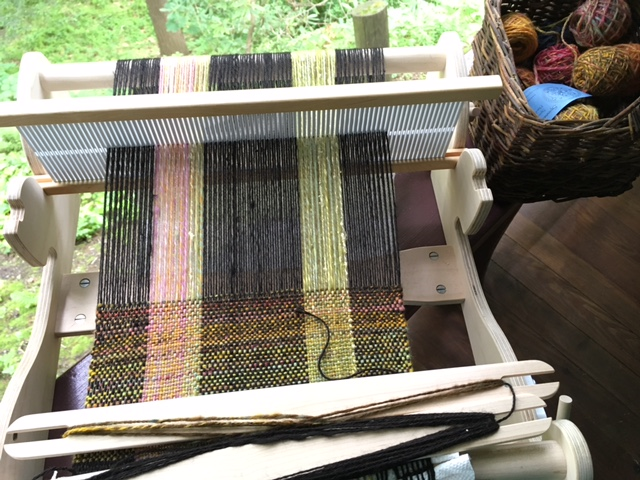 Beautiful silky alpaca from Spinner's End Farm (and some leftover handspun) create the warp. I'm using handspun Hobbledehoy battlings for the weft.