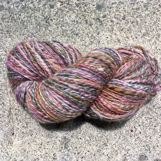 Valentino: Spindle-spun / wheel-plied rolags. 3.8 oz. / 354 yards of sport-weight 2-ply.